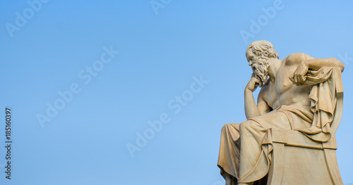 Obraz Ancient marble statue of the great Greek philosopher Socrates on background the blue sky.  - fototapety do salonu