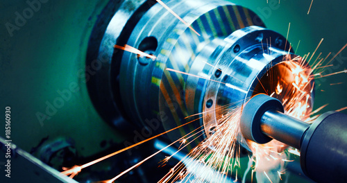 Fotografie, Obraz  sparks flying while machine griding and finishing metal