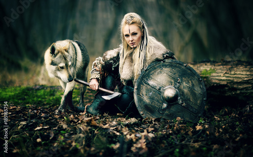 Fotografie, Obraz  Viking Warrior Woman  with a woolf in the woods