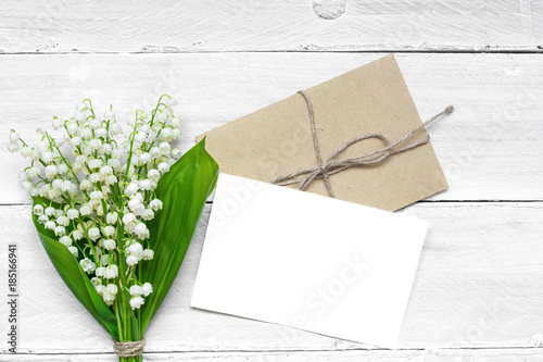 Poster Muguet de mai blank white greeting card and envelope with spring lily of the valley flowers