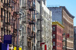 New York City style apartment buildings along Mott Street in the Chinatown neighborhood of Manhattan NYC