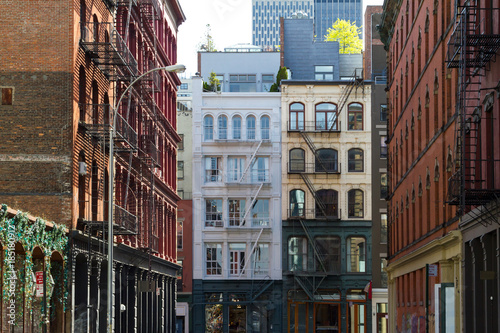 Photo Stands New York Historic buildings at the intersection of Crosby and Howard Street in the SOHO neighborhood of Manhattan, New York City NYC