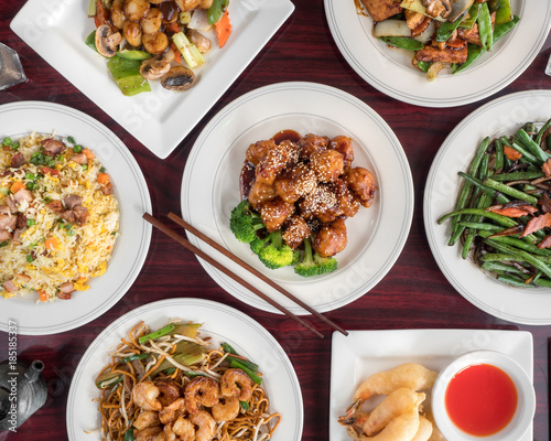 Sesame chicken, fried rice, shrimp and tofu in Chinese retaurant