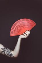 Woman Holding A Red Fan