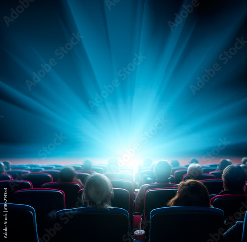 Photo  viewers watch shining light in the cinema