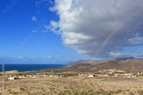 Tuinposter Canarische Eilanden Cloudscape with rainbow over La Pared village, Fuerteventura