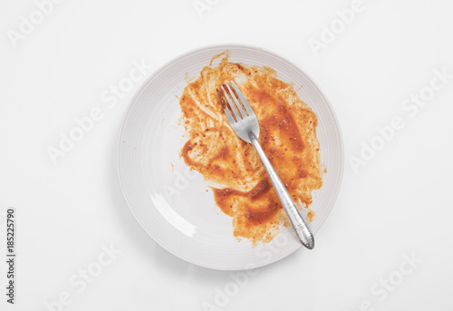 top view dirty dish and fork on white table. Canvas Print