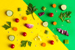 Leinwanddruck Bild - Eating pattern with raw ingredients of salad, lettuce leaves, cucumbers, red tomatoes, carrots, celery on colorful green and yellow background