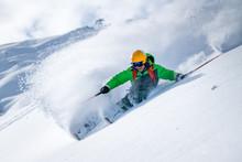 A Male Skier Skiing In Powder Snow At The Kitzsteinhorn Glacier Near Salzburg In Austria.