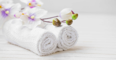 Obraz na płótnie Canvas Spa still life with orchid flower and towels, selective focus