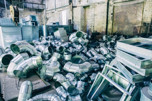 Fototapety, obrazy: Iron blanks for the production of industrial ventilation systems, a group of metal pipes in the shop