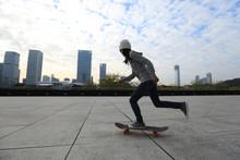 Female Skateboarder Riding Wit...