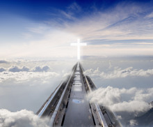 Railway Tracks Leading Among The Clouds To The Glowing Cross