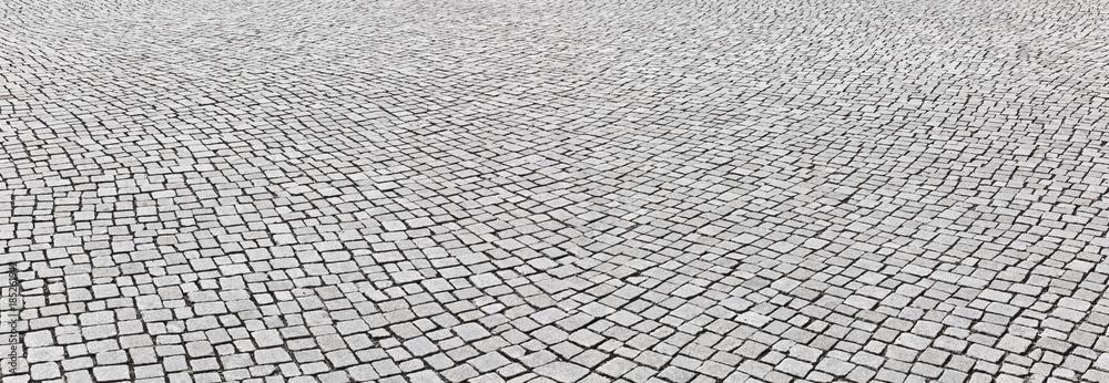 Fototapeta Kopfsteinpflaster im Panoramaformat