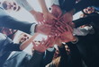 Leinwanddruck Bild - Large successfull business team showing unity with their hands t