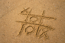 Tic-tac-toe Drawing In Sand Ba...