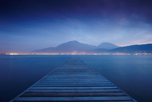Wooden Jetty On Sea Sunset And...