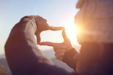 Close Up Of Woman Hands Making Frame Gesture With Sunrise On Moutain, Female Capturing The Sunrise, Future Planning, Sunlight Outdoor.