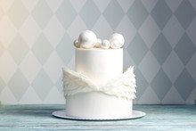 Festive White Cake Decorated With Wings Of Mastic And Chocolate Balls On Top. Concept Ideas Desserts For Kids