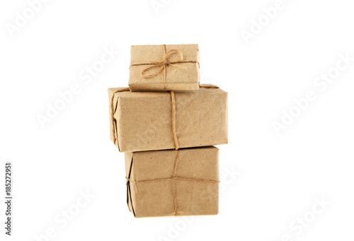 postal packet packed in gray paper bundled rope isolated on white background Canvas Print