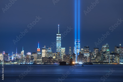 Photo Stands New York City The two beams of the Tribute in Light with skycrapers of Lower Manhattan at night from New York Harbor. Financial District, New York City