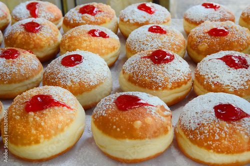 traditional hanukkah sufganiyot with strawberry jelly