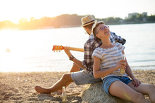 Young Couple Is Having Good Time On A Beach