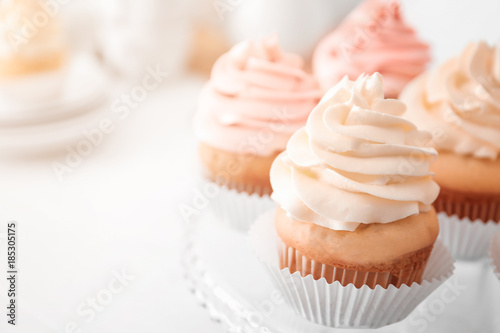 Photo  Tasty cupcakes on stand