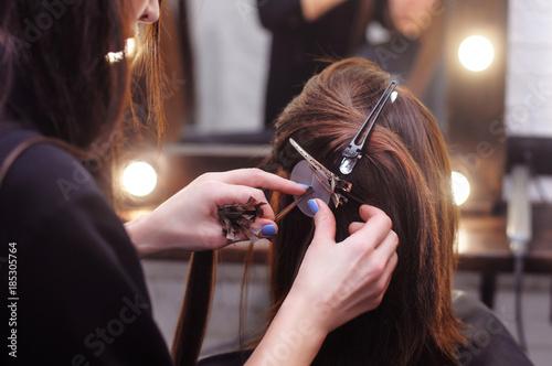 Obraz na plátně  hair extension for brunette girls in the salon