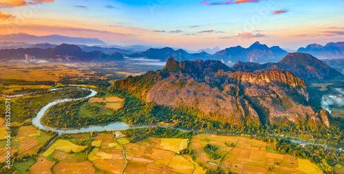 Aerial view of the fields, river and mountain. Beautiful landscape panorama. Laos.