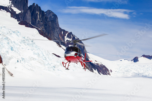 Poster Helicopter rescue helicopter landing on a glacier.