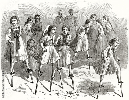 Fotografia, Obraz  Old illustration of girls playing on stilts