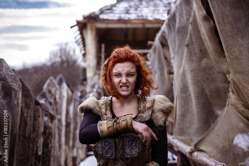 Fotografie, Obraz  Viking woman with hammer in a traditional warrior clothes.