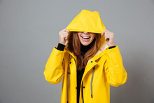 Portrait Of A Smiling Girl Dressed In Raincoat