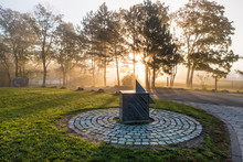 Sundial With Sunrise And Silho...