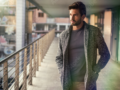 Fotografia  One handsome young man in urban setting in European city, standing