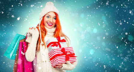 Shopping woman holding color bags and gift box on winter background with cnow in black friday, Christmas and New Year holidays. Sale poster with copy space.