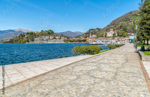 Foto auf Gartenposter Stadt am Wasser Lakeside promenade of city Laveno Mombello on the lake Maggiore shore in province of Varese, Italy