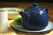 Blue Teapot With Tea And Cereal For Breakfast