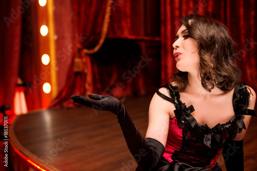 Elegant dancer in moulin rouge style sends an air kiss from the stage Canvas Print