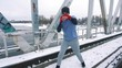 Training boxer on the bridge in winter slow mo