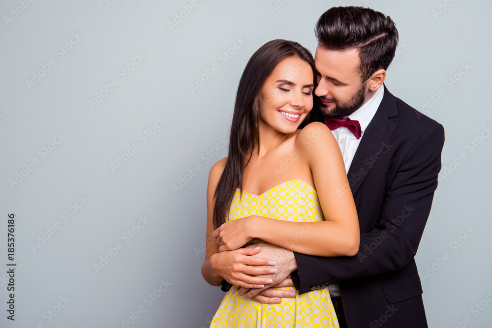 Fototapety, obrazy: Photo  of beautiful, cheerful, positive, cute, sensual, tender couple  enjoying hugs with each other having eyes close over grey background  with copy space, gentle husband's hands touch his wife