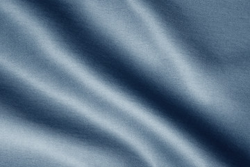 texture of dark blue fabric with large diagonal folds, abstract background