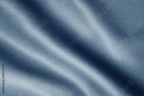 Tuinposter Stof texture of dark blue fabric with large diagonal folds, abstract background