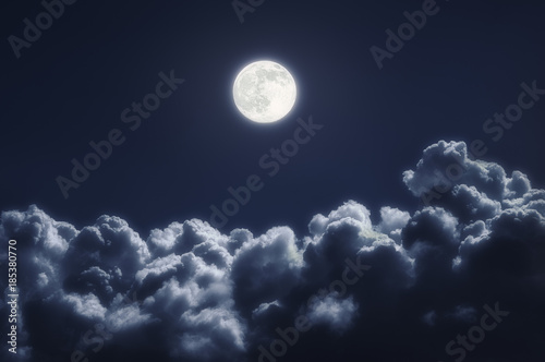 cloudscape at night with full moon