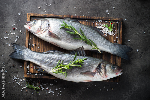 Foto op Plexiglas Vis Fresh fish seabass on black background.