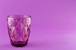 canvas print picture - Purple color empty drinking glass cup on bright purple background