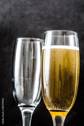 Champagne glasses on black background