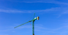 Tower Crane Ready For Lifting On Blue Sky Background. Space For Text.