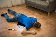 Dead Man Body Lying On Floor At Crime Scene